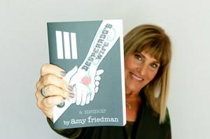 Amy Friedman holding book