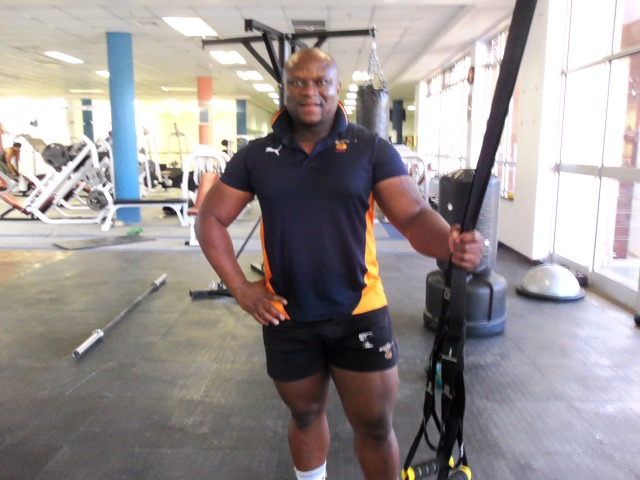 Vincent the trainer at LeHakoe gym, proud to show off his muscles