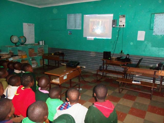 Kids watching Shrek video-back view