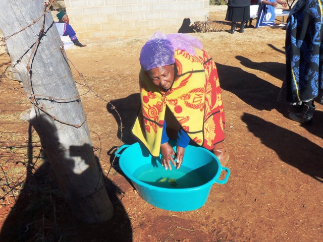 Mary washing hands before our meal at Basotho Funeral