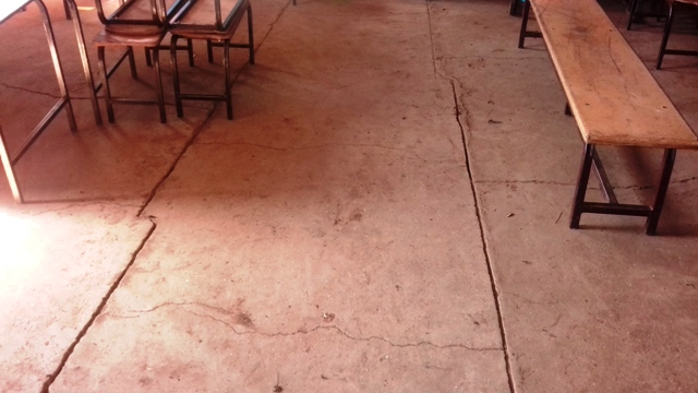 Cracks on cold cement floors in classrooms