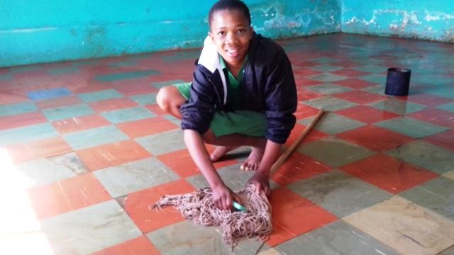 Girl mopping 7th grade floor