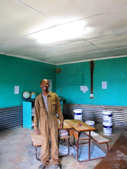 The electrician who has installed lights in the staff room at school.